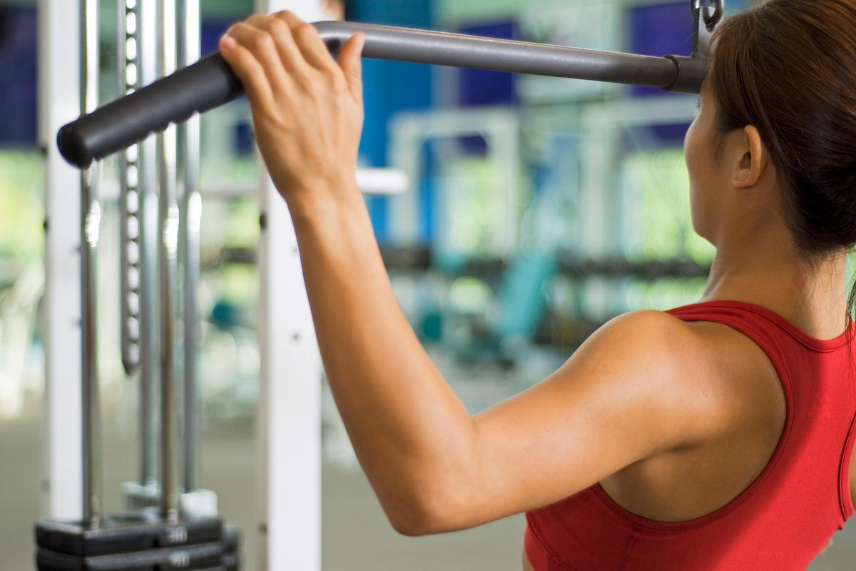 Woman-Pull-ups-Weights-Workout-Fitness